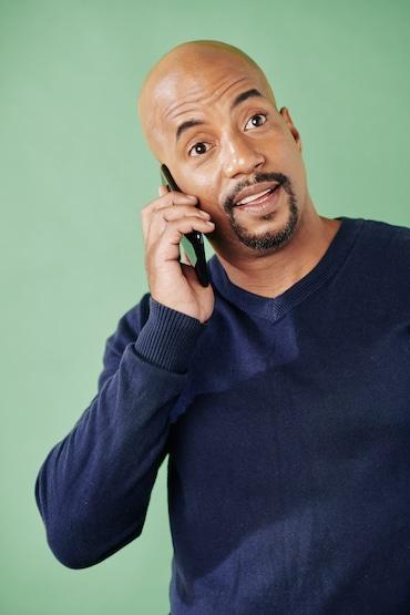 Cheerful man talking on phone